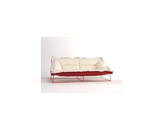 Eco Friendly Furnture and Lighting - Volant Sofa.The structure is basic and self-sufficient. The frame of the base appears orthogonal but in actual fact is a trapezium for adapting to the line of the back and seat. This leads to a shape dichotomy between regularity and irregularity, also in the perception of the seat elements which, despite the fact they seem flat, have curved sections to provide extreme comfort.