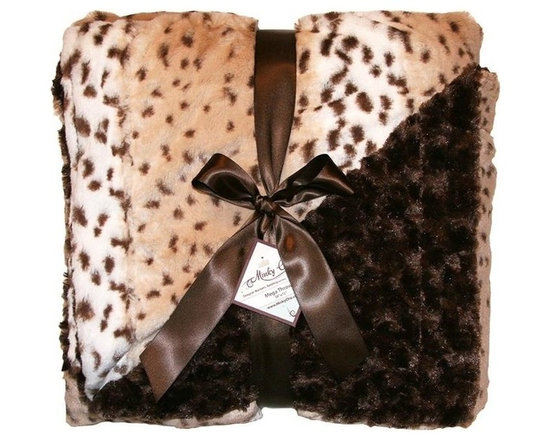 Belle & June - Snow Leopard Cream Throw - Channel a bit of the the seductive Central Asian, alpine snow leopard with this cozy, feline faux throw. Rich chocolate fur on one side, the other, thick rosette patterned faux fur. Wrapped in it, you will purr with pleasure.