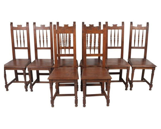 Pre-owned English Oak Dining Chairs - Set of 8 - Set of eight high back English oak dining chairs with spindle backs. Turned wood on the seat backs and legs for a stately traditional look!