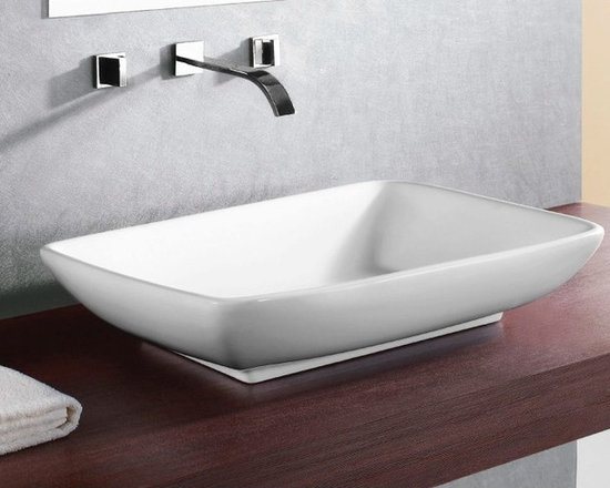 "Stylish Rectangular White Vessel Ceramic Sink - This stylish rectangular vessel sink is made of high-quality ceramic and comes in a white, glazed finish. Its contemporary design comes without an overflow and has no faucet holes. Designed in Italy by Caracalla. Sink dimensions: 24.02"" (width), 5.71"" (height), 18.11"" (depth)"