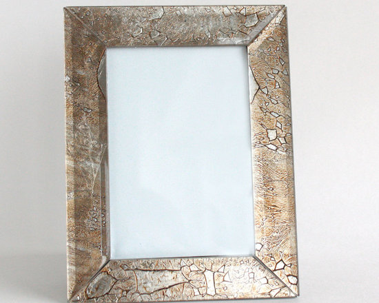 Silver Leaf Picture Frame - With a distressed silver leaf finish and shimmering gold undertones, this picture frame is classic yet eye-catching. The silver leaf is placed under a beveled glass frame to create shimmering marble effect.