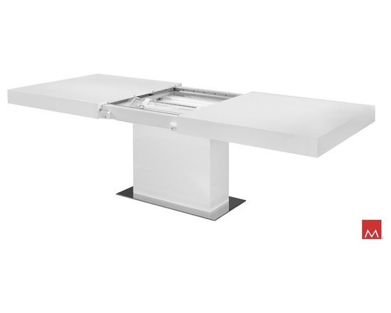 """Astor Contemporary Dining Table by ModLoft - The Astor extendable dining table is the perfect solution for your spatial problems and caters to all dining needs in your home. It easily transforms from a medium size (71"""" - seats up to 8) to an extra large size (94"""" - seats up to 10) table. The table top easily extends from the center to reveal an automatic center leaf. The mechanism within the table allows the tops to glide smoothly for perfect alignment every time. Table features generous proportions of 71L x 40W x 30H and extends to 94in. length. Available in either wenge or walnut wood finishes. Also available in white lacquer finish. Assembly required. Imported."""