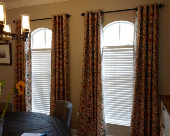Drapery Ideas - Grommet panels over arched windows.