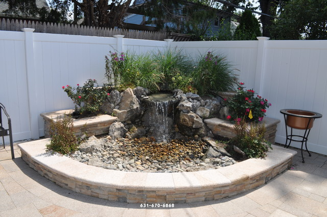 Pond Less Waterfall With Granite Paving Stones Patio