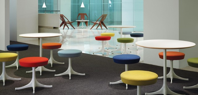 Collaboration area with Medici Chairs, Nelson Pedestal Stools and Table modern