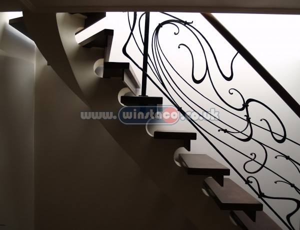 Bespoke curved staircase, wrought iron balustrade contemporary staircase