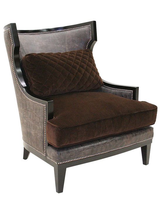 "Old Hickory Tannery - Haines Leather Chair - DARK BROWN - Old Hickory TanneryHaines Leather ChairDetailsEXCLUSIVELY OURS.Only one available.Handcrafted wing chair.Hardwood frame with hand-painted coffee-bean finish.Polyester/cotton and top-grain leather upholstery.Springs are hand tied to the frame and surrounding springs at eight points for lasting comfort and stability.34""W x 37""D x 39""T.Made in the USA.Boxed weight approximately 80 lbs. Please note that this item may require additional shipping charges.Designer About Old Hickory TanneryFounded more than 30 years ago Old Hickory Tannery is still family owned and operated in Hickory North Carolina. Although the company's name reflects its original focus on fine leather upholstery Old Hickory is now equally well know for fabric-covered seating. Its range of styles is impressive from dramatic Duncan-Phyfe-style sofas to graceful Queen Anne armchairs claw-footed tub chairs feminine full-skirted settees and sleek slipper chairs. Old Hickory's craftsmen bring an abundance of expertise to their work; some have been making furniture for almost half a century. All upholstery is cut and sewn entirely by hand all frames are solid hardwood nailhead trim is hand-hammered and all springs are hand-tied to the frame and surrounding springs at eight points for lasting comfort and stability. These are just a few of the reasons why this American furniture maker is one of our favorites."