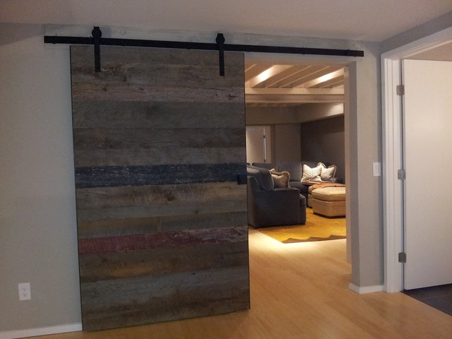 barn wood accent wall and sliding door rustic