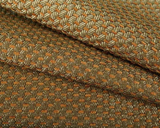 Kas-Pita Upholstery Fabric in Spice - Kas-Pita Taupe Geometric Upholstery Fabric in Spice has a small-scale, peppy geometric pattern that will bring a tan and taupe-green glow to interior designs. This discount designer fabric is perfect for upholstery projects or accent pillows. Made from a blend of 73% rayon, and 27% polyester, this light upholstery fabric passes 15,000 double rubs on the Wyzenbeek Abrasion Test. Cleaning Code: S; UFAC: Class I; passes CA117 Test. Width 54″; repeat .38″ x .38″.