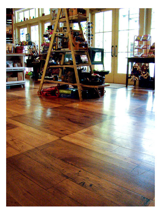"Southern Pecan - This is a 4-7"" wide plank Southern Pecan flooring. We stained it in a checker board pattern to give this toy store a playful look."