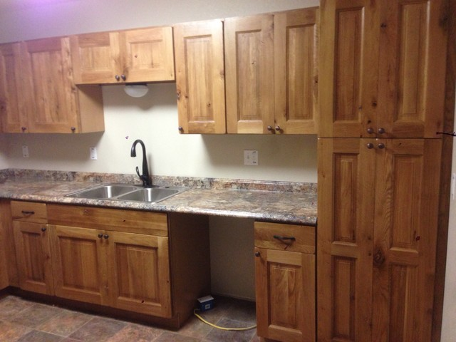 Rustic knotty oak for Rustic kitchen cabinets