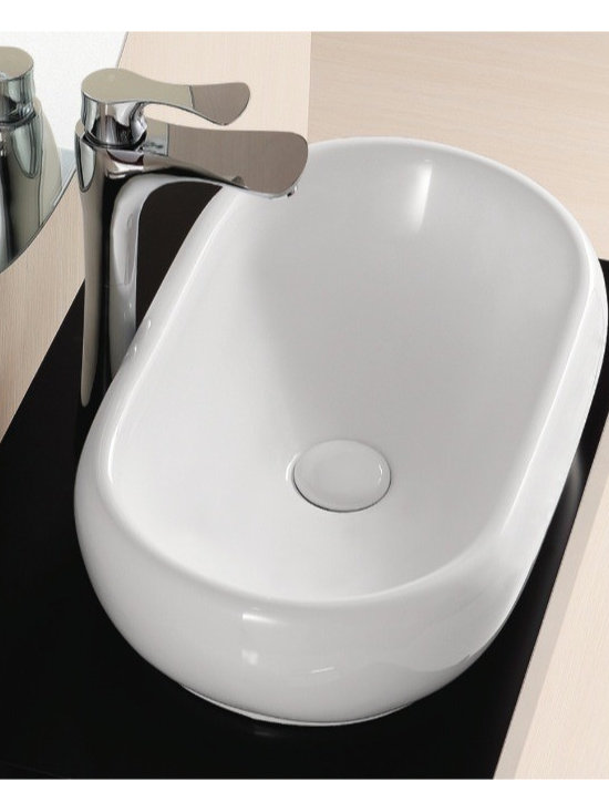 "Caracalla - Sleek Oval Modern Vessel Bathroom Sink by Caracalla - Sleek extended oval shaped white ceramic bathroom sink. Modern above counter vessel sink designed in Italy by Caracalla. Vessel sink comes without overflow and has no option for faucet holes. Sink dimensions: 19.68"" (width), 5.31"" (height), 12.01"" (depth)"