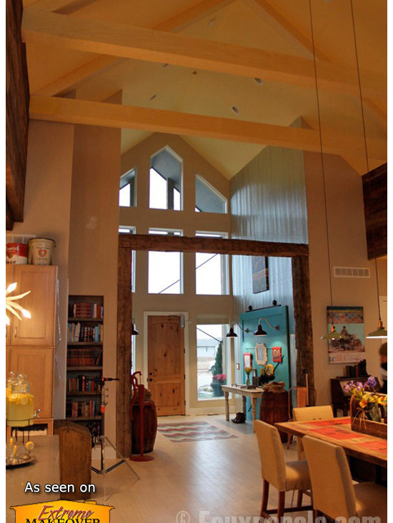 Sandblasted Faux Beams - Faux beams are used in two different ways in this Extreme Makeover: Home Edition build. First, the entranceway is framed with faux wood in a natural finish to help delineate the foyer from the rest of the room. Second, the simple triangular beam shapes of the ceiling are made using painted faux wood beams for a subtler touch.
