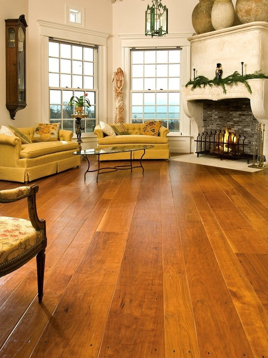 Cherry Floors - As a flooring material, Cherry is also unique in that as it ages, its lustrous hues will darken a bit more than will other hardwoods, and ultimately mature to a rich, burnished auburn color. The subtle but distinctive flowing grain patterns and uniquely inviting warmth make Cherry one of our most popular floors.