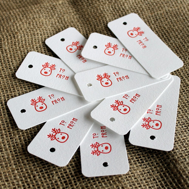 Red Reindeer Letterpress Gift Tags by Shortgrass Designs modern-holiday-accents-and-figurines