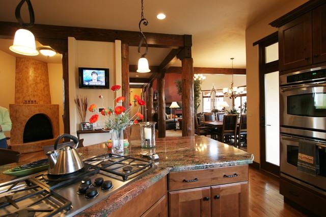 Pueblo southwest style traditional kitchen denver for Southwest style kitchen cabinets