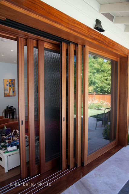 Sliding doors on to pool deck contemporary-windows-and-doors