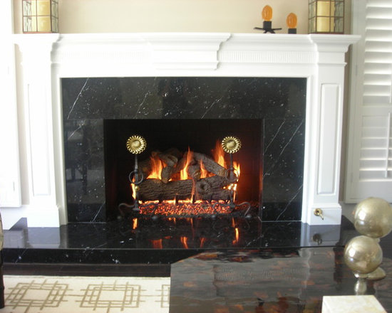Custom Items - Gas logs with brass and iron sunflower andirons.