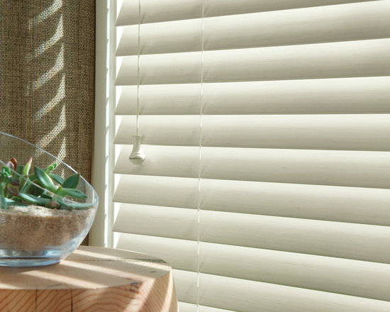 """Hunter Douglas® Everwood Faux Wood Alternative Wood Blinds - EverWood® Distinctions™ blinds feature a versatile color selection of best-selling white finishes, from crisp white to elegant ecru. Constructed from our premium, polystyrene formulation, these blinds come with our exclusive Performance Plus™ Protection against fading, yellowing, warping or bowing. Perfect for heat and moisture areas. Available in 2"""" flat and 2 1/2"""" beveled slat sizes."""