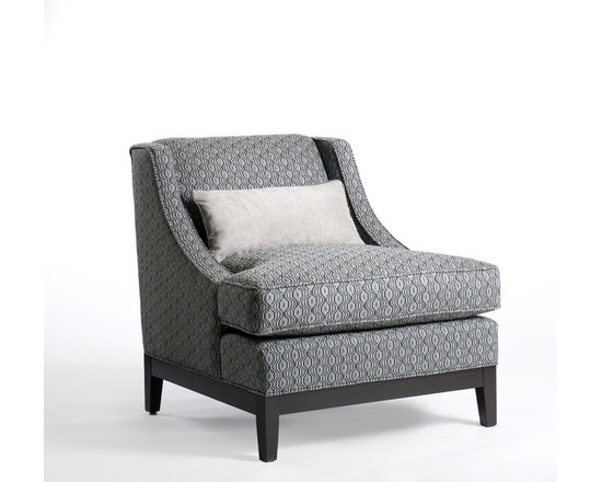 Barry Chair - Barry's elegant form with gently sloping side arms, is perfect for any room where conversation and comfort are imperative. Shown clad in a modern print of slate blue and flannel gray, the character and sophistication of this timeless design is further enhanced. A contrasting kidney pillow in solid gray adds a clean feel to the chair's textured fabric.