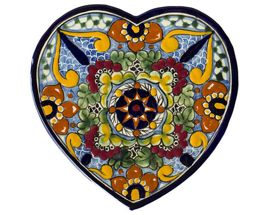 Native Trails - Talavera Heart Trivet in Geraniums - Add color and warmth to your kitchen with our Talavera Heart Trivet in Geraniums. Inspired by outdoor gardens, this ancient design provides the setting for this bold combination of royal blue with earthy greens and sunny yellows. Each trivet is handmade using clays and minerals local to the artisans, intricately hand painted, and then twice fired to bring out the striking colors and create a durable finish.