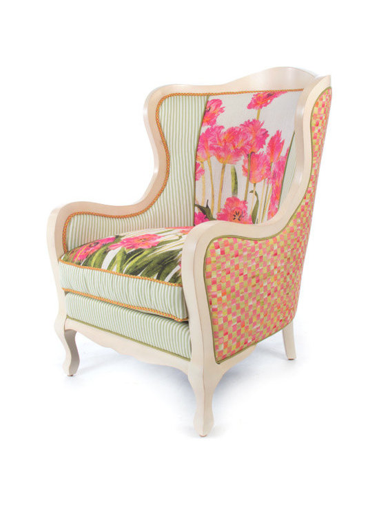 Tulip Wing Chair | MacKenzie-Childs - Like sitting in an impressionist painting; a truly exquisite experience. Dreamy watercolor florals in verdant and blush tones, ticking stripes, checked accents and piping, and vines and bright blossoms that pop. Even if you reside in the harshest of concrete jungles, Tulip Furniture provides a respite as welcome and inviting as the secret garden you've long imagined. Equally sublime as a separate seat or grouped together.