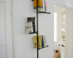 Industrial Pipe Bookshelf with Antique Knob by Dirty Bils eclectic-display-and-wall-shelves