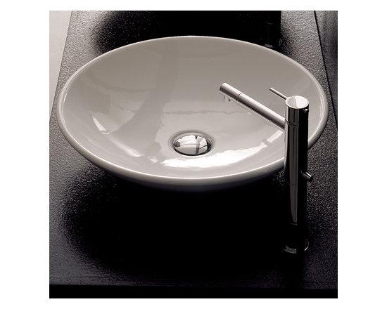 "Scarabeo - Stylish Circular Above Counter Vessel Sink by Scarabeo - Stylish round white ceramic above counter vessel bathroom sink. Contemporary washbasin with shallow, saucer-like shape designed and manufactured in Italy by Scarabeo. Sink comes without overflow and has no faucet holes. Sink dimensions: 18.10"" (width), 18.10"" (depth)"
