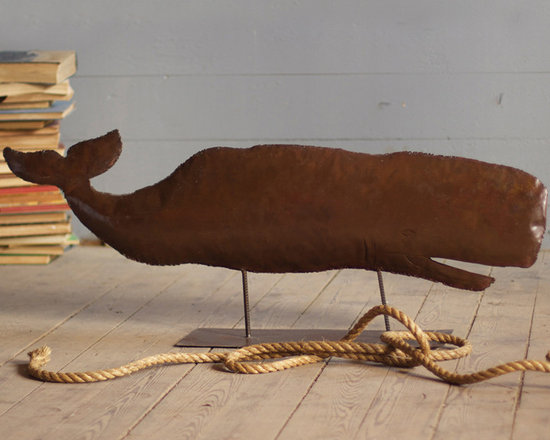 """Large Rustic Iron Whale Sculpture - The Large Rustic Iron Whale Sculpture has a perfectly worn rustic finish to create a lovely contrast against the vibrant colors found in most beach homes. This sculpture measures 48"""" x 18"""" and is sure to be a focal point in any room. These unique, hand-crafted accessories are imported from small cottage industries in Colombia, Honduras, Haiti, Morocco, and more. Dimensions: 48""""w x 18""""h"""