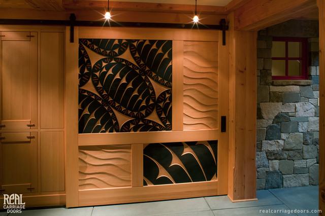 Sliding Barn Door with Art Carvings craftsman-hall