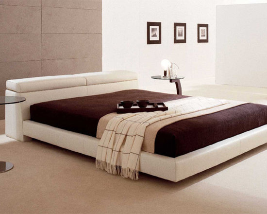 Logan Leather Bed By Cattelan Italia - Reinvent the way you sleep with the Logan Leather Bed,which features a specialized mechanism to adjust the height of the headboard. Graceful,the bed is softly padded to create true relaxation and peace.