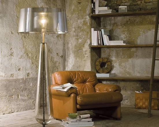New Classic Floor Lamp by Penta Light - New Classic Floor Lamp by Penta Light. Lamps with structure in opaque anthracite nickel and blown glass in the following colours: transparent, fumé or amber. Available also in golden or silver leaf (only table). Interchangeable shades in different sizes in the fabrics of the collection and glossy mirroring PVC in the colours silver or black. New Classic Floor Lamp by Penta Light are designed by Gaia Bellavia.
