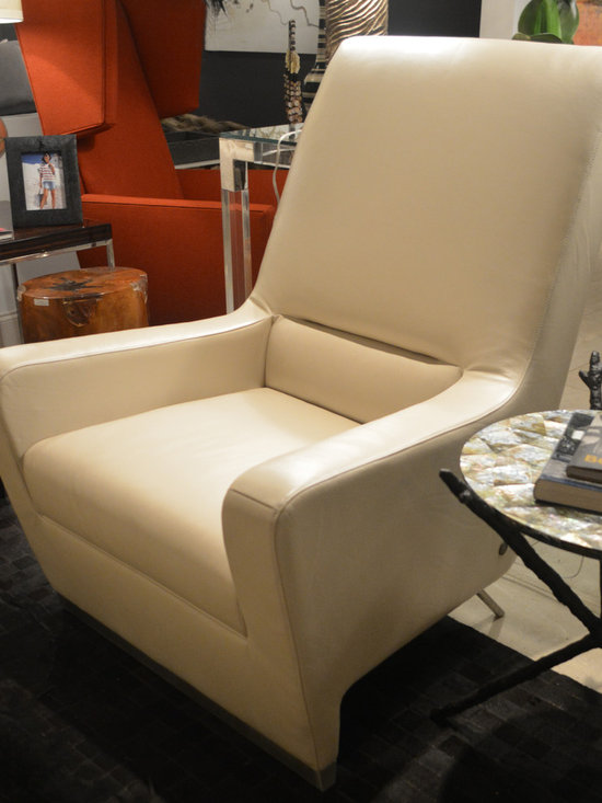 Showroom Pieces - Accent chair in a toasted marshmallow leather.