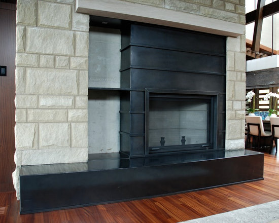 Fireplaces - Custom designed, hand forged, wrought iron fireplace hearth and screen.