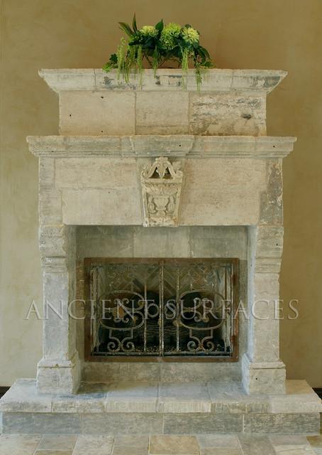 Antique Stone Fireplaces mediterranean-indoor-fireplaces