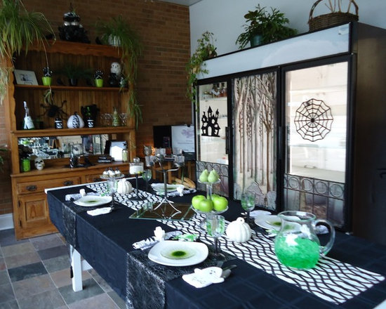 Halloween tablescape and hutch - Halloween tablescape and an old hutch-It's a fun, contemporary Halloween display by using Black & White tableware & acessories with a shock of green!