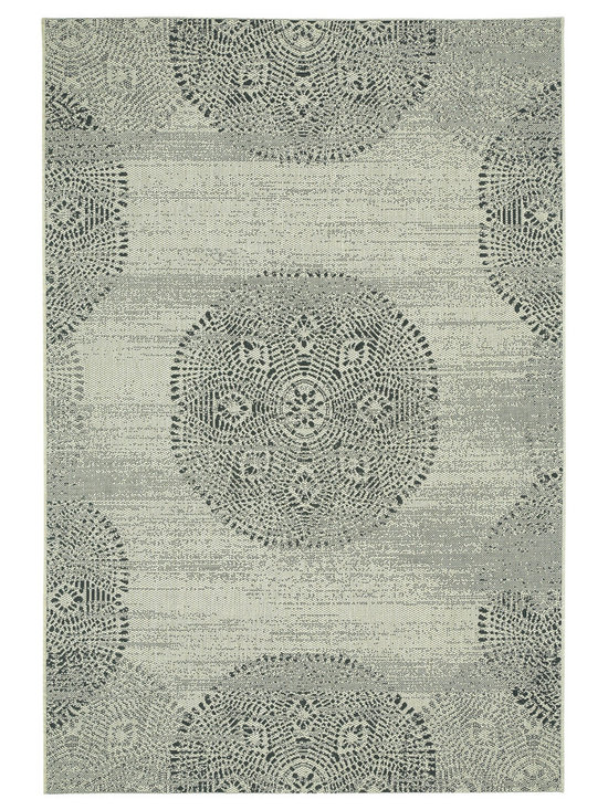 Finesse Mandala rug in Noir - Finesse Mandala takes intricate and familiar patterns from centuries old designs and brings it into a landscape ... your backyard. Why should precious only live inside? Distressed and seemingly aged, these rugs will add contrast and richness to any deck or patio.