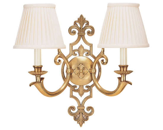 "Inviting Home - Solid Brass Wall Sconce - Brass wall sconce; 19-1/2""W x 8-3/4""D x 18""H; Electrified two light wall sconce has a sophisticated design in the foreground and with leaf motif scrolls and stylized leaf motif rosette in the center. This beautiful sconce is hand crafted from solid brass and has an antiqued finish. Brass sconce has gracefully scrolled arms and round pleated fabric shades. This wall sconce is for candelabra bulbs only. UL approved for indoor use - hardwire application."