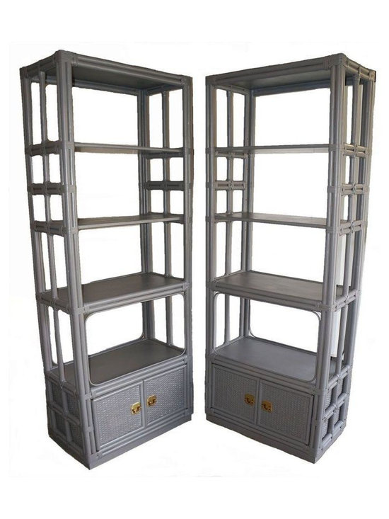 Pre-owned Grey Rattan Etageres - A Pair - A pair of Mid-Century style rattan etageres painted granite grey. Each has 4 shelves, 2 of them being adjustable & a bottom storage cabinet with woven doors that boast original brass pulls. The units have great details & tons of storage/display shelves. There are some imperfections due to age, small imperfection of woven area by pull on one door. The right door of one unit sticks slightly.