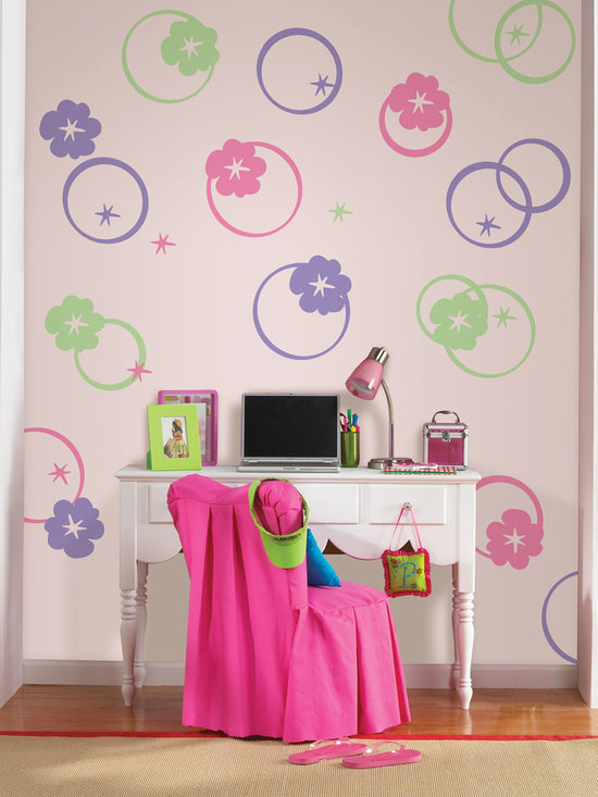 "Hooplah Pieces Set of Wall Decals - Round and round we go...fun concentric circles create very cool walls. This pack contains thirty-six hooplah pieces on twelve 13"" x 13"" sheets (twelve pink, twelve green, and twelve purple). WallPops are repositionable and always removable."