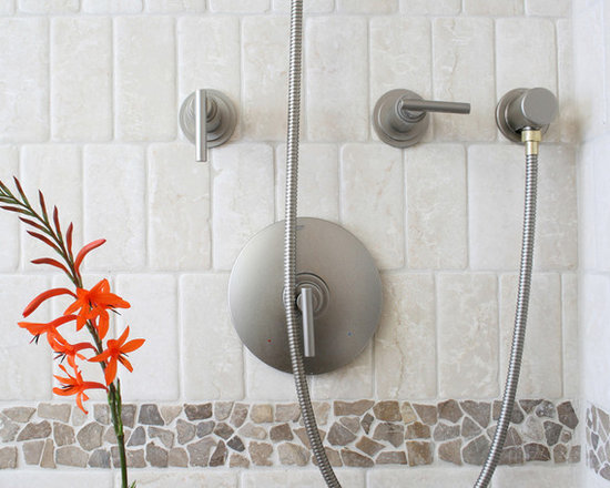 Island Stone random tile bathroom shower and sink - Random Tile brings a unique and dramatic design statement to any space. Using unique random shaped and sized stones to we create customized tiles that interlock seamlessly to cover any area. Our unique means of  individually creating each interlocking tile insures that your installation will be completely custom, while retaining the premier look and quality for which we are known.