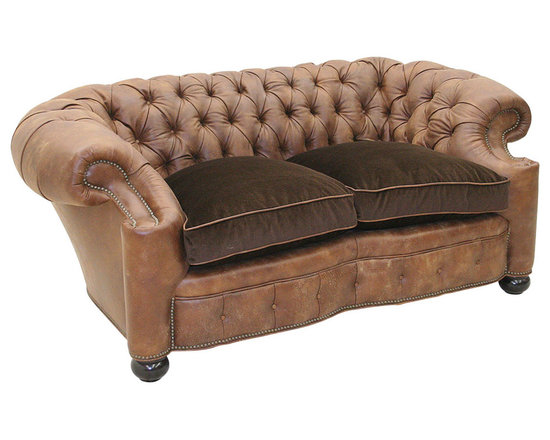 "Old Hickory Tannery - Reid Tufted Leather Loveseat - OLIVE - Old Hickory TanneryReid Tufted Leather LoveseatDetailsEXCLUSIVELY OURS.Handcrafted loveseat.Maple frame with hand-painted coffee-bean finish.Distressed leather and acrylic/nylon upholstery.Tufted inside back inside arms and front seat rail.Springs are hand tied to the frame and surrounding springs at eight points for lasting comfort and stability.68""W x 36""D x 30""T. Seat 24""D x 21""T; arms 30""T.Made in the USA.Boxed weight approximately 110 lbs. Please note that this item may require additional shipping charges.Designer About Old Hickory TanneryFounded more than 30 years ago Old Hickory Tannery is still family owned and operated in Hickory North Carolina. Although the company's name reflects its original focus on fine leather upholstery Old Hickory is now equally well know for fabric-covered seating. Its range of styles is impressive from dramatic Duncan-Phyfe-style sofas to graceful Queen Anne armchairs claw-footed tub chairs feminine full-skirted settees and sleek slipper chairs. Old Hickory's craftsmen bring an abundance of expertise to their work; some have been making furniture for almost half a century. All upholstery is cut and sewn entirely by hand all frames are solid hardwood nailhead trim is hand-hammered and all springs are hand-tied to the frame and surrounding springs at eight points for lasting comfort and stability. These are just a few of the reasons why this American furniture maker is one of our favorites."