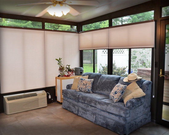 Sunroom and Cellular/Honeycombs - Our customer wanted to enjoy the beauty of her sunroom but too much heat from direct sun and lack of privacy at night made it difficult. With cellular/honeycomb shades from Springs Window Fashions, now she can enjoy the her sunroom day and night.