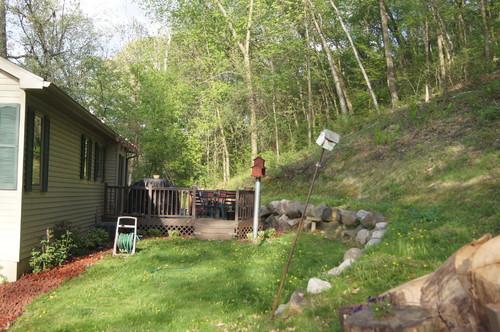 sloping backyard design help. Black Bedroom Furniture Sets. Home Design Ideas