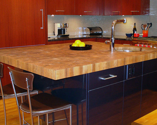 Teak Butcherblock Countertop with Undermount Sink by Grothouse - 3 inch Plantation Teak in honey and brown colors with 1/8 inch Roundover edge profile and a Food Grade Oil finish. Special feature is an undermount sink. Designed by Venegas and Company LLC, Boston, MA. Photography courtesy of Grothouse Lumber Co.