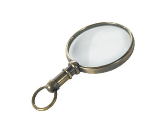 """Inviting Home - Mini Magnifying Glass Pendant - mini magnifying glass pendant; 3"""" x 1-3/4"""" Small brass magnifying glass in a duotone bronze finish. This magnifier is a tool for the curious of mind. Mini magnifier is practical authentic and highly decorative. You found an unbelievable Tizian sketch in rich sepias highlighted in white. You examined the faded signature enlarged� That ancient piece of ikat textile. You always wanted to study the weft see how the weaver worked. That picture of grandmother in a group of 27 classmates from 1919. Did she wear earrings?"""