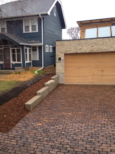 Cream House with Permeable Pavers contemporary