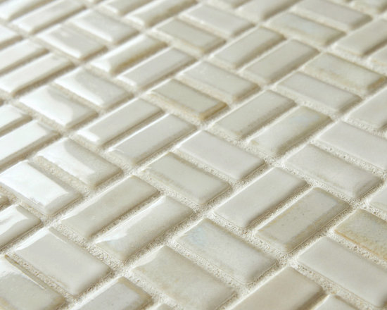 Rustica Weave Glacier 12 in. x 12 in. x 6mm Porcelain Mosaic Floor and Wall Tile - The Merola Tile Rustica Weave Glacier 12 in. x 12 in. x 6 mm Porcelain Mosaic Floor and Wall Tile is far from your average white tile.  Imported from Japan, subtle shades of cream, white, and bone combine with variances in color, texture and glaze make each tile unique.  The variance in color, texture and glaze in each tile in your installation will be totally unique and coordinate beautifully with a variety of decorative schemes. This luxury-grade, heavy duty tile is suitable for a number of fixtures in your interior or exterior space.. Photo by Merola Tile.