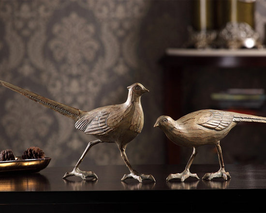 Pair of Birds Sculptures - Infuse a charming touch of nature into your décor with our lovely Pair of Bird sculptures. Finished in antique bronze tones, this appealing set of cast iron delights, complete with long tail feathers and curved claws, make the perfect gift for the birdwatcher in your life.