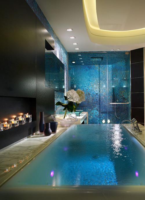 baño lujoso y moderno con ceramica aqua y bañera infinita